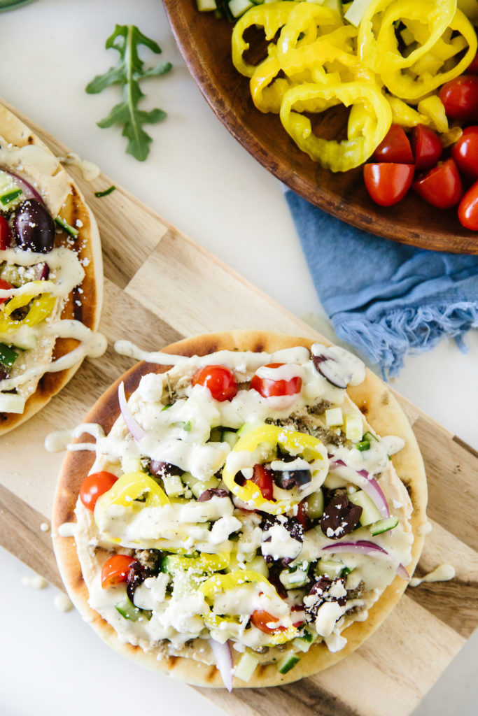 Grilled Pita Pizzas on a wooden serving tray